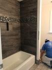 dark tub surround with care